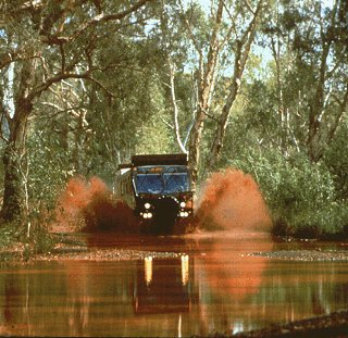 The expedition vehicle fords a river.