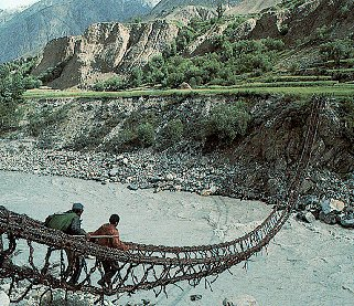 Crossing a river on a rope bridge in Pakistan.