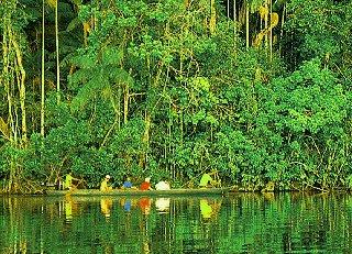 Plying jungle waterways by dugout canoe.