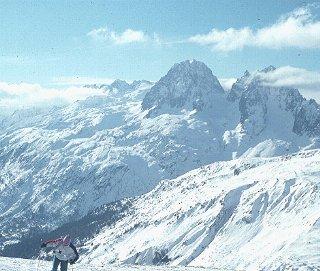A skier on the Alpine slopes.