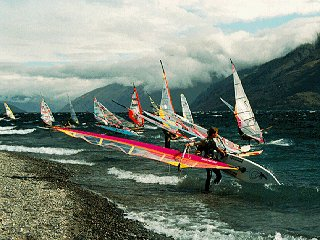 Windsurfers on New Zealand's coast.