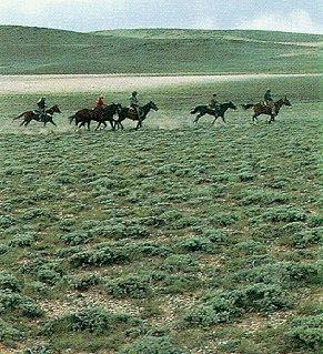Riders thunder along the Pony Express Trail.
