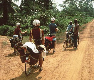 Bicycling along the rural road in Africa.