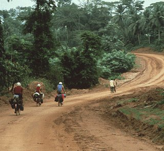 Bicycling on an African road.