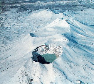 Fly over dormant craters on Kamchatka.