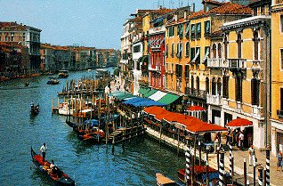 The colorful canals and gondoliers of Venice.