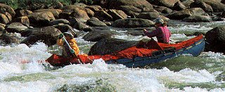 Canoists enjoy some whitewater action.