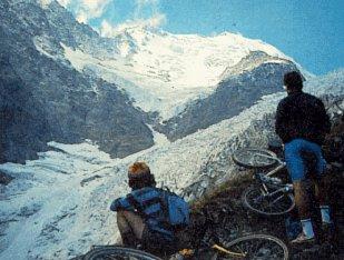 Bikers pause to view Glacier de Bionnassay.