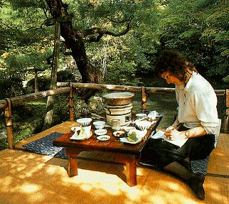 A visitor writes at Yudofu Restaurant in Kyoto.