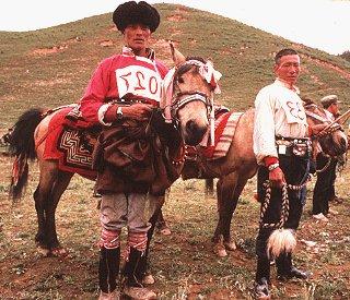 Tibetan horsemen waiting for a racing competition.