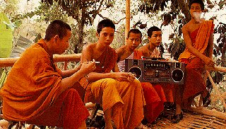 Thai monks have a smoke and enjoy music.