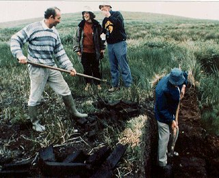 Cutting turf in an Irish peat bog.