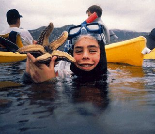 A young diver surfaces with a discovery.